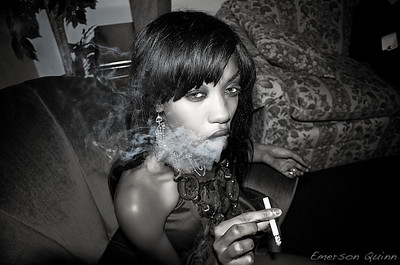 Young woman smoking in her chair