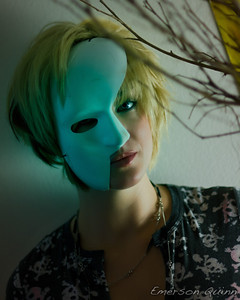 Blonde woman in half-face mask