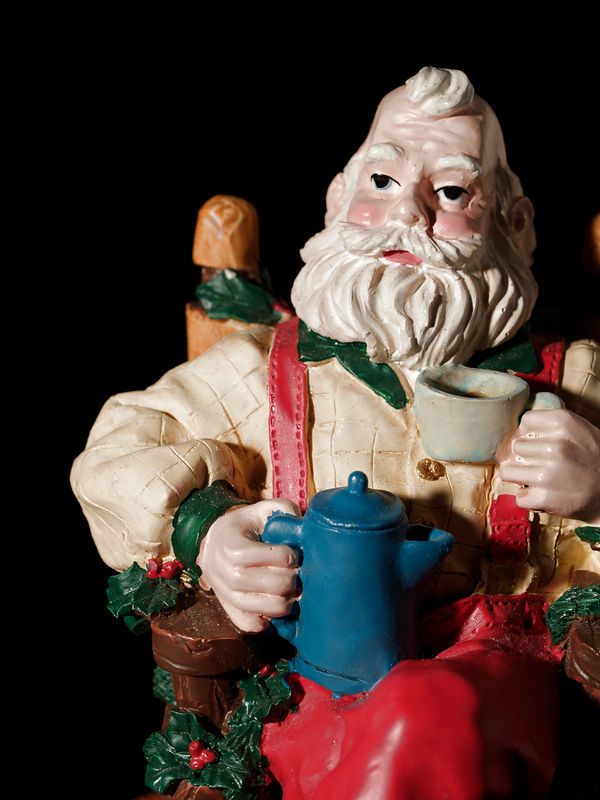 Old St. Nick relaxing after a hard night with a cup of coffee.