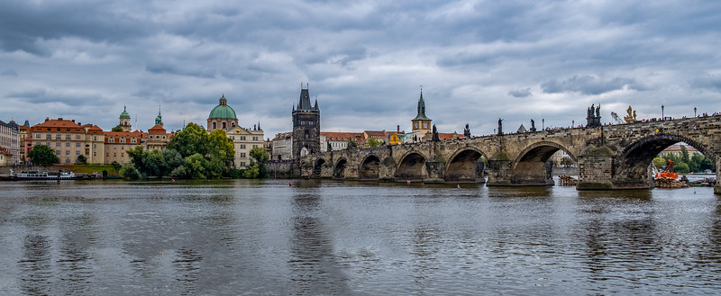 The Charles Bridge Where Hundreds Of Tourists Congregate