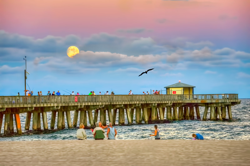Locals gather at Pompano pier during moonrise