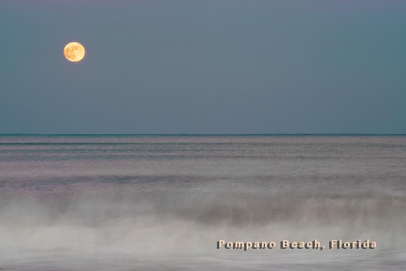 Rising moon over Pomapno Beach from shoreline