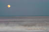 Rising moon over Pomapno Beach from shoreline
