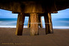 Underneath Pompano Beach pier during moonrise