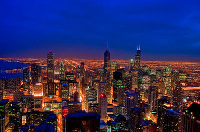 A blue hour photograph of Chicago's skyline taken from the Hancock Observatory.