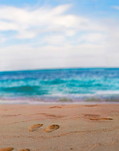 Footprints in the beach at Grace Bay, Providenciales, Turks and Caicos Islands.