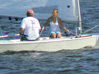 "Kate and Sandy Downes at the Comet Internationals, Miles River Yacht Club, 2007 sailing ""Reckless Abandon."""