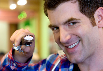 "Food Network host, Adam Gertler, shows off a Zzang Bar while filming an episode of ""Kid in a Candy Store"" at Zingerman's Bakehouse in Ann Arbor, MI."
