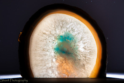 A geode shows a pattern of light when backlit.