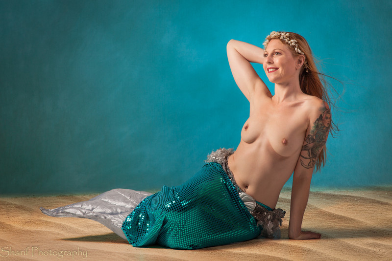 In preparation for our mermaid shoot on the beach we practiced with our model Serena in the studio. I gave this picture the Cosmo treatment...