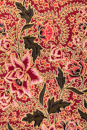 A batik pattern of roses on a piece of fabric bought in Malaysia.