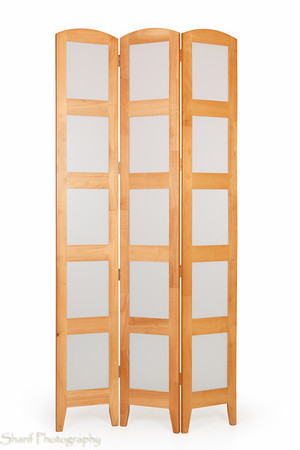 A one-of-a-kind folding screen in light oak composed of transparant squares.