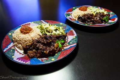A home-made meal in Mexican style: beef stew with dried fruit,rice and a vegetable dish with bell peppers and zucchini.