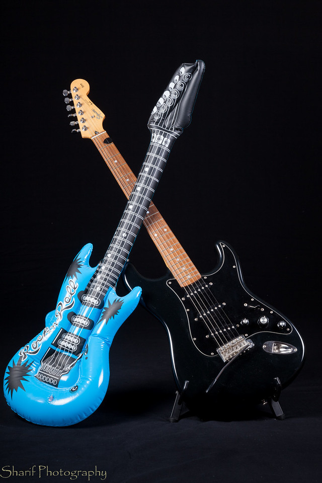 An electric guitar and its not so serious cousin battle it out in dueling guitars.
