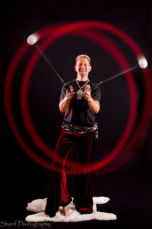 Self-portrait with balls - the LED poi variety. This pattern is called the butterfly.