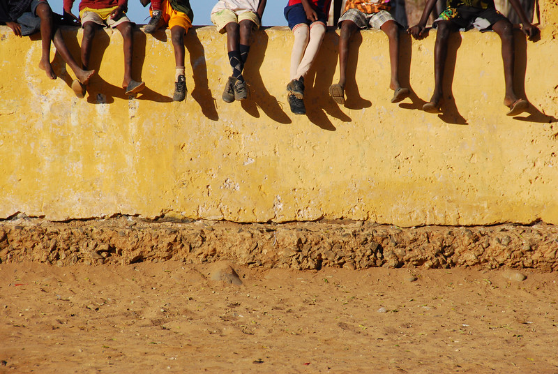 Also in Senegal but on a small island that played a significant role in slave trade history. Boys were lined up on a wall to play the next soccer match.