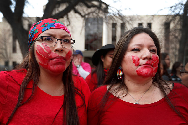 Emily Enick, left, and RoyAnn Enick, of the Crow Tribe, watch during the program following the Missing and Murdered Indigenous Women's March on the lawn of the Yellowstone County Courthouse in Billings, Mont. on Friday, April 5, 2019.