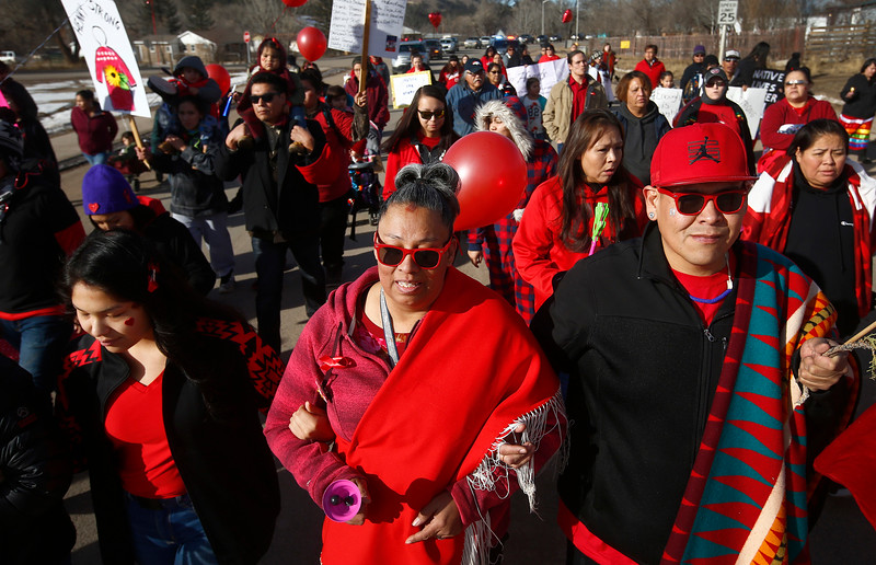 "Paula Castro, center, mother of 14-year-old Henny Scott, leads a march to the Chief Little Wolf Capitol Building to call for justice for her daughter's death in Lame Deer, Mont. on Wednesday, January 9, 2019. ""It's just like, I'm still numb,"" Castro said. ""I want answers. There's too many questions out there, and nobody's giving us answers."""