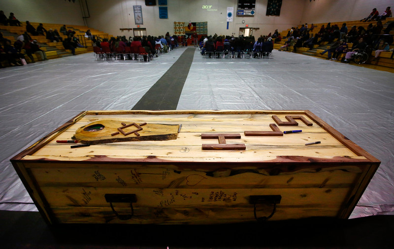 The coffin box for 14-year-old Henny Scott sits at the back of the high school gym, where she played on the basketball team, during her funeral service at Lame Deer High School in Lame Deer, Mont. on Saturday, January 5, 2019.