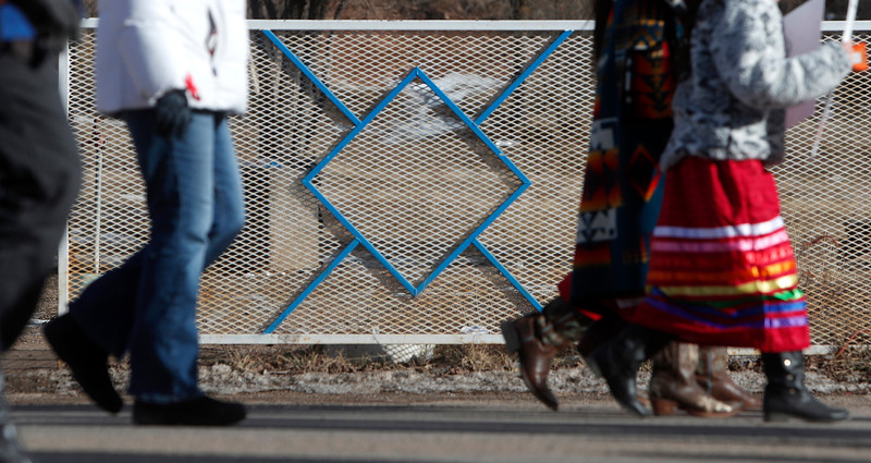 "Community members walk past a fence adorned with the Morning Star, a Northern Cheyenne tribal symbol, as they march to the Chief Little Wolf Northern Cheyenne Capitol Building on Henny Scott's birthday to call for justice for the 14-year-old's death in Lame Deer, Mont. on Wednesday, January 9, 2019. ""You can feel the love, it's just overwhelming,"" Paula Castro said. ""Just, to show up for her, it's just like … she don't even know how many lives she touched."""