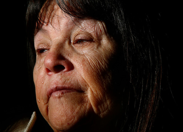 """Mary Wilson looks out her window as she marks her first birthday without her 42-year-old daughter Harriet Wilson in her home in Billings, Mont. on Friday, March 1, 2019. Harriet Wilson's body was pulled from the Yellowstone River in Billings, Montana on April 22, 2018. """"I just want justice for Harriet,"""" she says. """"And all the other ones out there."""""""