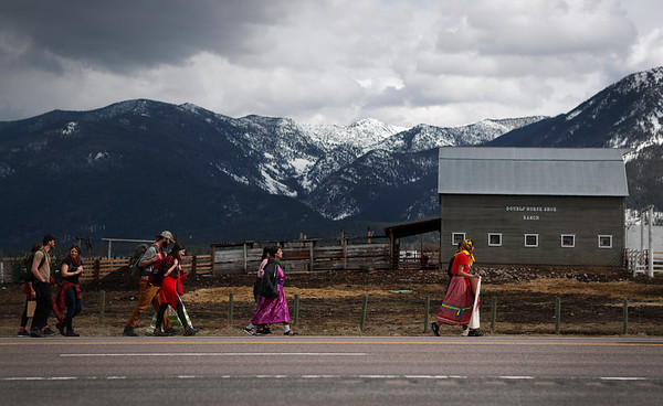 Supporters walk along Hwy. 93 as Marita Growing Thunder leads a group on an 80-mile annual trek across the Flathead Indian Reservation to raise awareness for Missing and Murdered Indigenous Women north of Arlee, Mont. on Sunday, March 31, 2019.