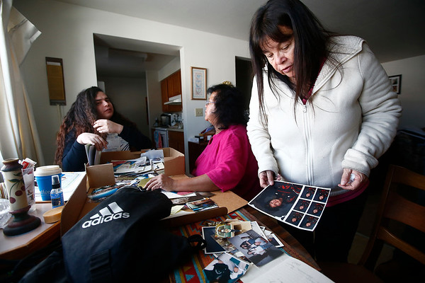 "Mary Wilson, mother to Harriet Wilson, goes through old photos of her daughter nearly a year after her death in Billings, Mont. on Friday, March 1, 2019. ""I feel like someone just locked me up. And I just feel like I'm in this cell and I can't get out, and I'm wondering why I'm here. And it's so hard. It's just, it's just so hard,"" Wilson said."