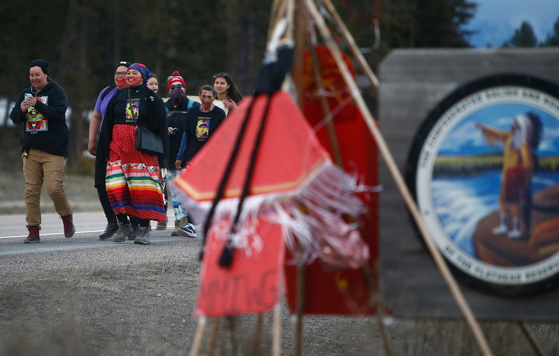 Marita Growing Thunder leads supporters to the end of an annual 80-mile trek across the Flathead Indian Reservation to raise awareness for Missing and Murdered Indigenous Women in Evaro, Mont. on Sunday, March 31, 2019.