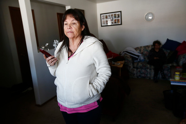 "Mary Wilson, mother to Harriet Wilson, speaks to Yellowstone County Sheriff's Detective Frank Fritz, the man investigating her daughter's murder, nearly a year after her death in Billings, Mont. on Friday, March 1, 2019. ""Today's my birthday, and I wanted to talk about my girl,"" Wilson says. ""How many deaths is it going to take, unsolved crimes like this?"" she asks."