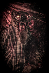 The Santee Werewolf at night. The Santee Werewolf is a life sized fully automated animatronic sculpture that I created in 2012. Controlled by a Programmable Logic Controller (PLC).