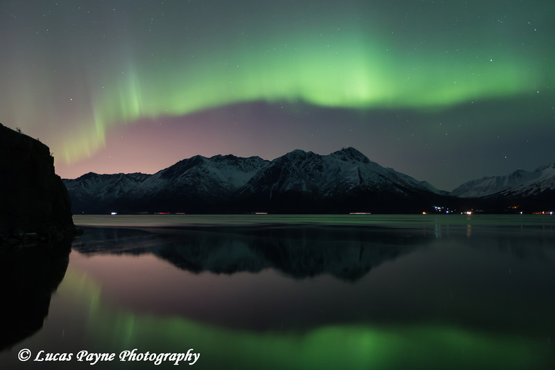 "<div class="""">View of the Aurora Borealis (Northern Lights) dancing above the Chugach Mountains and reflecting in the waters of Turnagain Arm, Alaska published in the <a href=""https://www.tripsavvy.com/december-weather-in-the-united-states-3301212"" target=""_blank""><b>TripSavvy article ""December in the United States: Weather, What to Pack, and What to See"" <br> <br> </b></a><b><a href=""https://www.tripsavvy.com/december-weather-in-the-united-states-3301212"" target=""_blank""><b>Click here to view photo and article.</b></a> <br> <br> <a href=""https://www.lucaspaynephotography.com/Alaska/Northern-Lights/i-p3sF2gK/A"" target=""_blank""><b>Click here to see this image in its original gallery.</b></a></b></div>"
