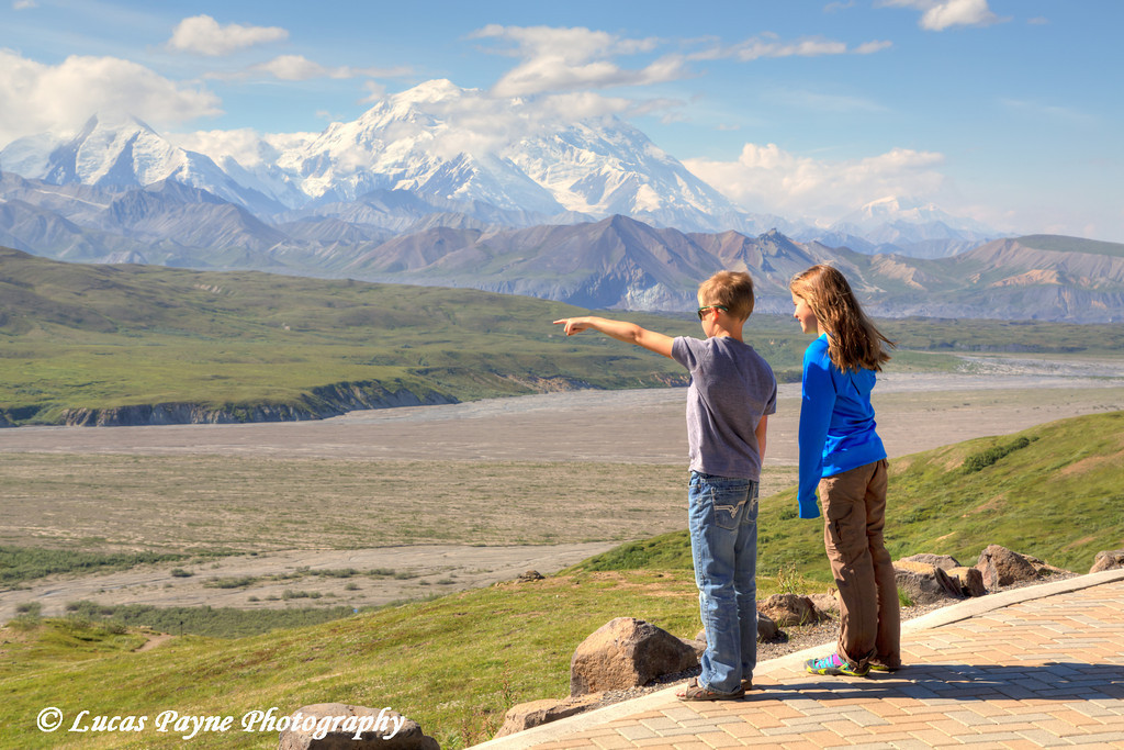 """<div class="""""""">Two children viewing Denali (Mt. McKinley) from the Eielson Visitor Center in Denali National Park and Preserve, Interior Alaska. <br>Published in an <a href=""""http://ee.usatoday.com/emag/Default.aspx?href=USAM%2F2015%2F06%2F15&pageno=85&view=document"""" target=""""_blank""""><b>Alaska Railroad Ad in the 2015 USA TODAY National Treasures Magazine</b></a> <br><br> <a href=""""http://ee.usatoday.com/emag/Default.aspx?href=USAM%2F2015%2F06%2F15&pageno=85&view=document"""" target=""""_blank""""><b>Click here to see the advertisement.</b></a></div>"""