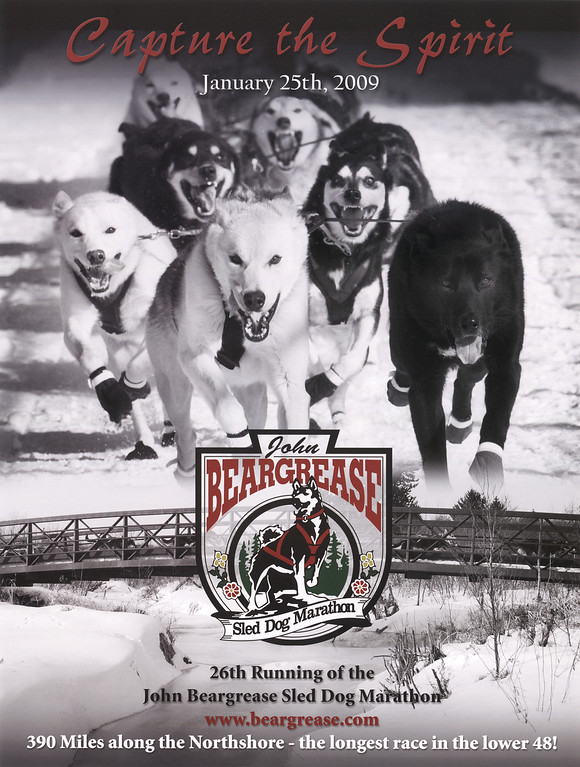 """<div class=>The 2009 John Beargrease Sled Dog Marathon Poster """"Capture the Spirit"""" is a composite of two of the winning images from the 2nd Annual John Beargrease Photography Contest. The top image of the dogs is my image and the lower image with the bridge is a photograph by Shane Anderson.</div>"""