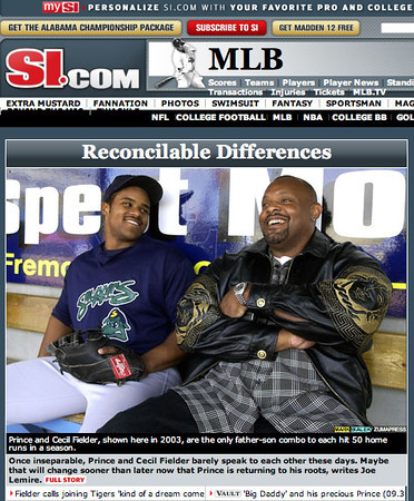 Prince Fielder, first baseman for the Beloit Snappers, left, and his dad Cecil talk in the visitors dugout before the start of the game between Beloit and West Michigan in Grand Rapids, Michigan on May 7, 2003.