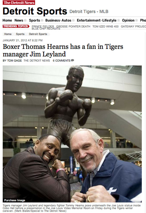 Detroit Tigers manager Jim Leyland and legendary fighter Tommy Hearns pose underneath the Joe Louis statue inside Cobo Hall during the Detroit Auto Show on Jan 20, 2012.  Leyland said he was thrilled when he found out he was going to meet Hearns.  Leyland has since retired as manager of the Tigers.