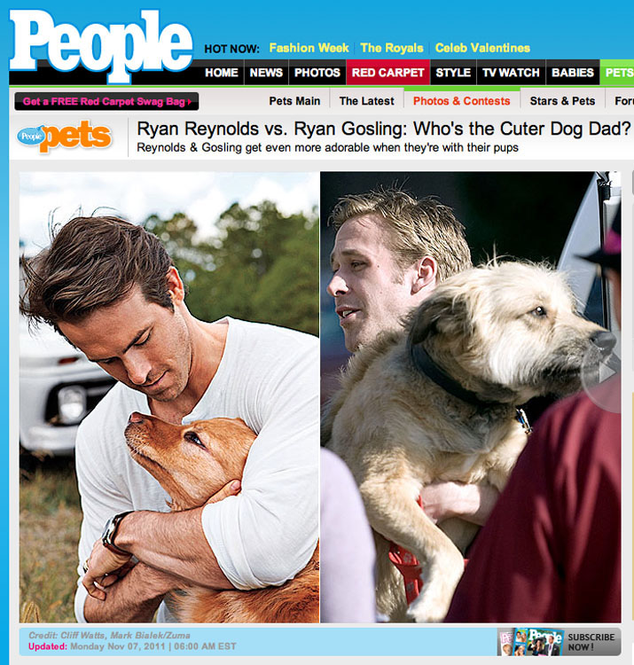"""Ryan Gosling, right, holds his dog, George, after wrapping up a day of filming on the set of """"Ides of March"""" in downtown Ann Arbor, MI."""