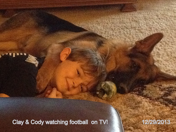 Clay and Cody watching football on a Sunday afternoon.