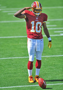 05-19-12 Robert Griffin III salutes during the rookie premier in Pasadena. by Manny Flores
