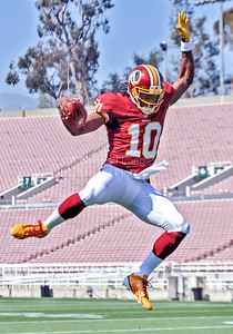 05-19-12 Robert Griffin III leaps and poses during the rookie premier in Pasadena. by Manny Flores
