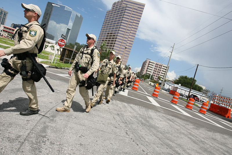 Police forces file down the street in formation, as they prepare to contain groups of protesters in the downtown area of Tampa, Florida on August 28th, 2012.