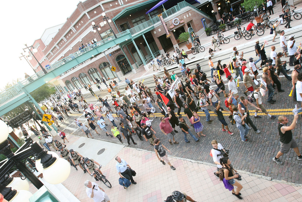 Protesters march down the streets of the Ybor City district of Tampa, Florida on August 28th, 2012.