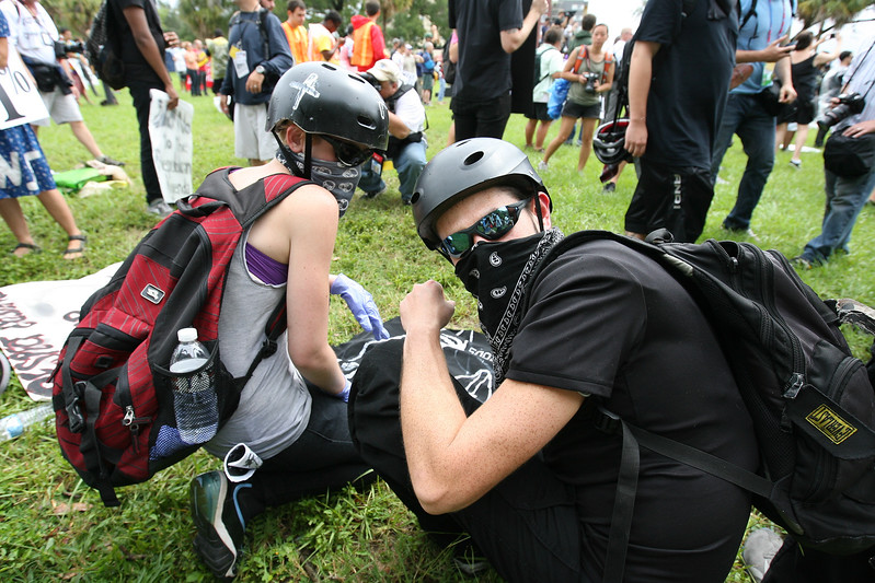 Members of the black bloc prepare a banner for the Coalition March on the RNC on August 27th, 2012.  The black bloc is a group of activists promoting anarchy, and traditionally cover their faces to avoid identification.