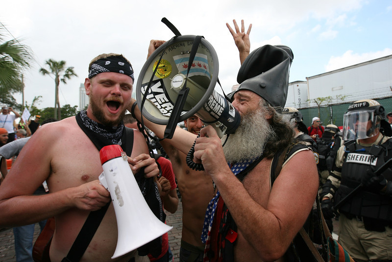 Democratic presidential candidate Vermin Supreme and Occupy activist Kevin Lash carry out a mocking rendition of the views shared by members of the Westboro Baptist Church who were sharing the public viewing area with several other protest groups.  August 28th, 2012.  Tampa, Florida.