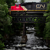 CN log train at L'Anse, Michigan crossing Middle Falls on the Falls River.