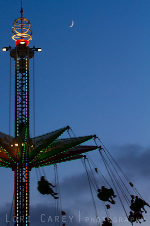 Orange County Fair silhouetted against twilight sky with moon
