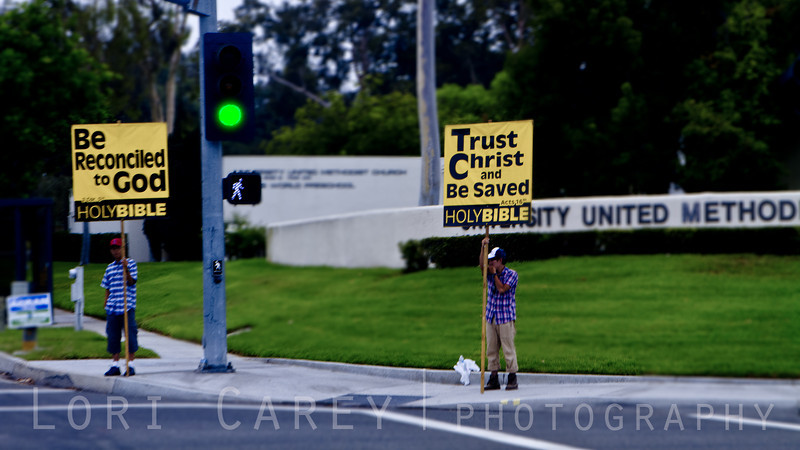 Sign Holders in front of Church in Irvine, California