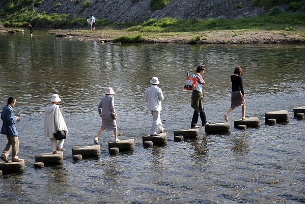 Crossing the Kamogawa River.