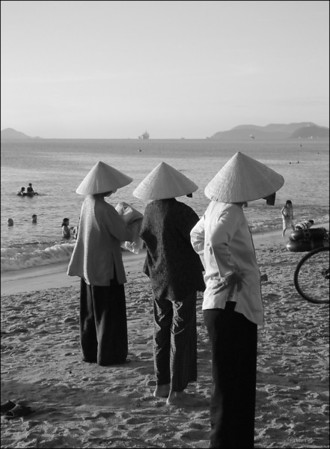 Sunrise on the beach in Nha Trang. Thousands of people gather every morning for various kinds of exercise.