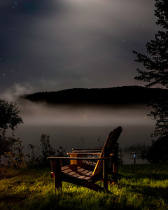 Light-painted chairs late at night on a lake in Quebec