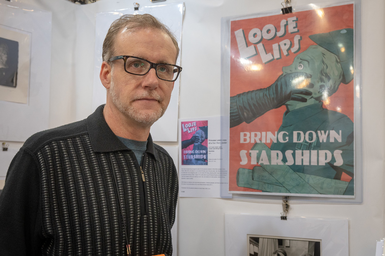 Neil MacDonald with a poster from Pinewood Studios